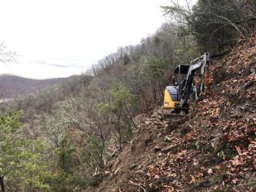 Excavator on Cliff